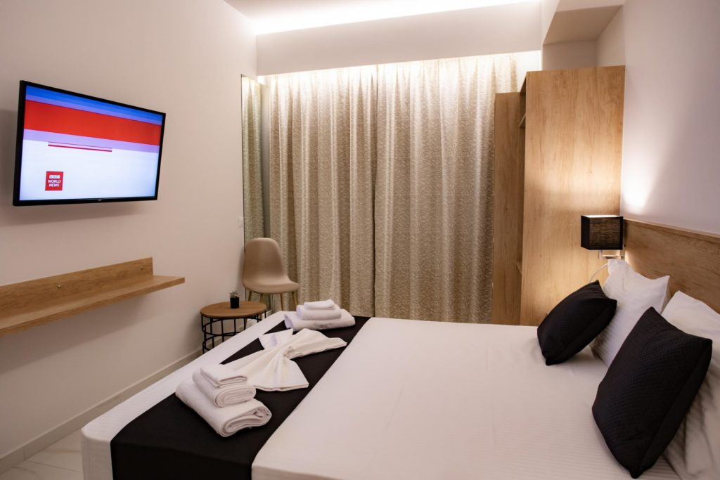Double Room Bed and TV Marvel Deluxe Rooms Heraklion Crete