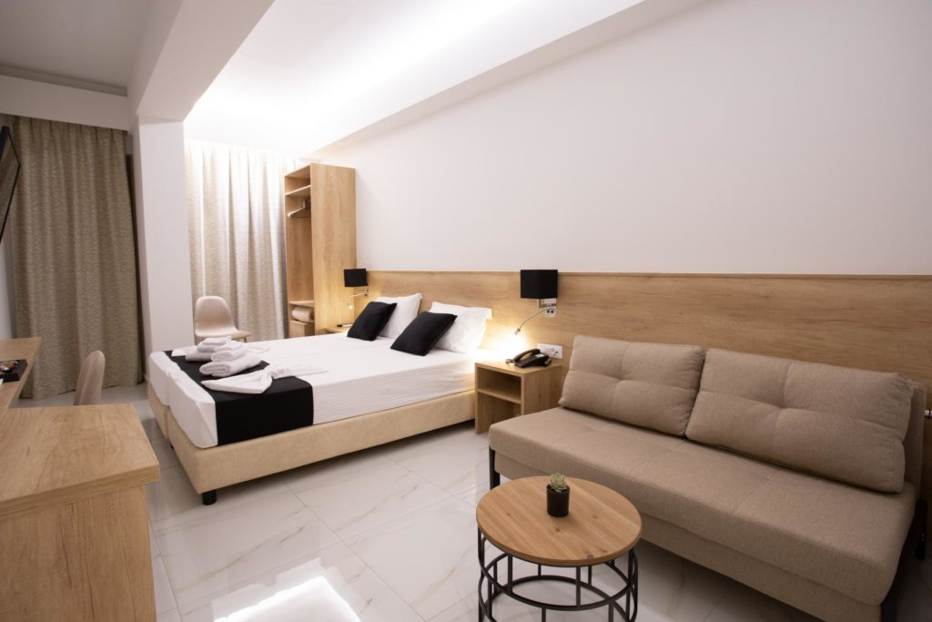 Double Room Sitting Area and bed Marvel Deluxe Rooms Heraklion Crete
