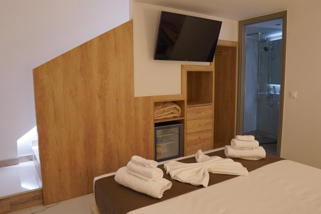 Quadruple Room Bed & TV 2-Marvel Deluxe Rooms Heraklion Crete